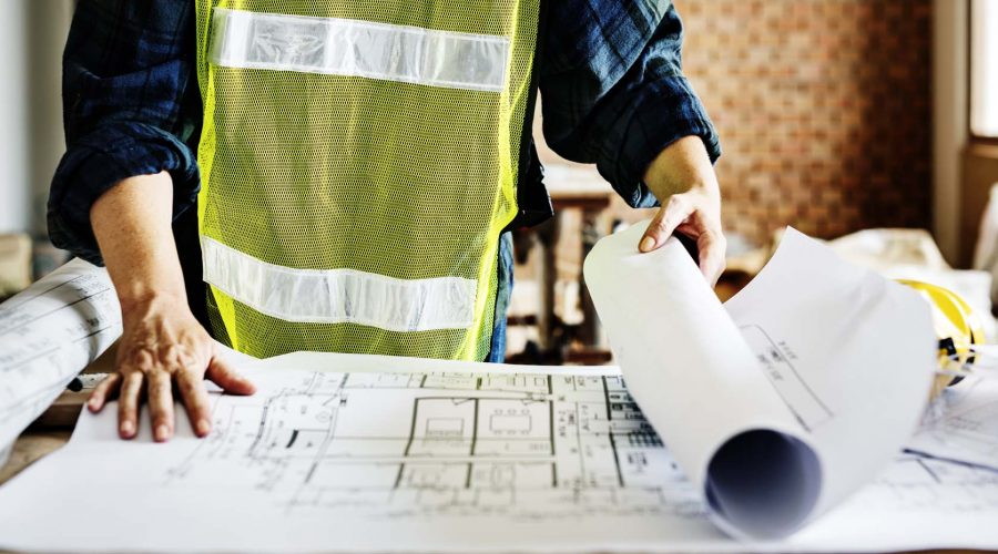 Architecture working on a blueprint