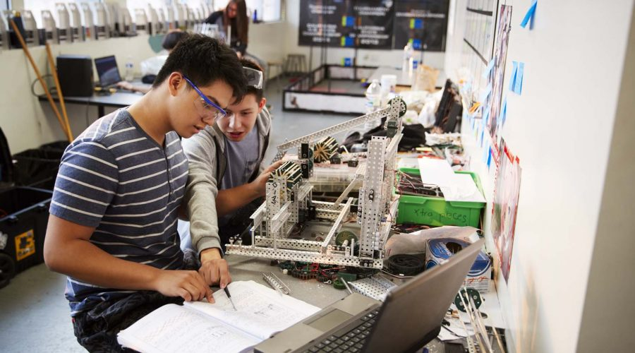 Two Male College Students In Computer Science Class
