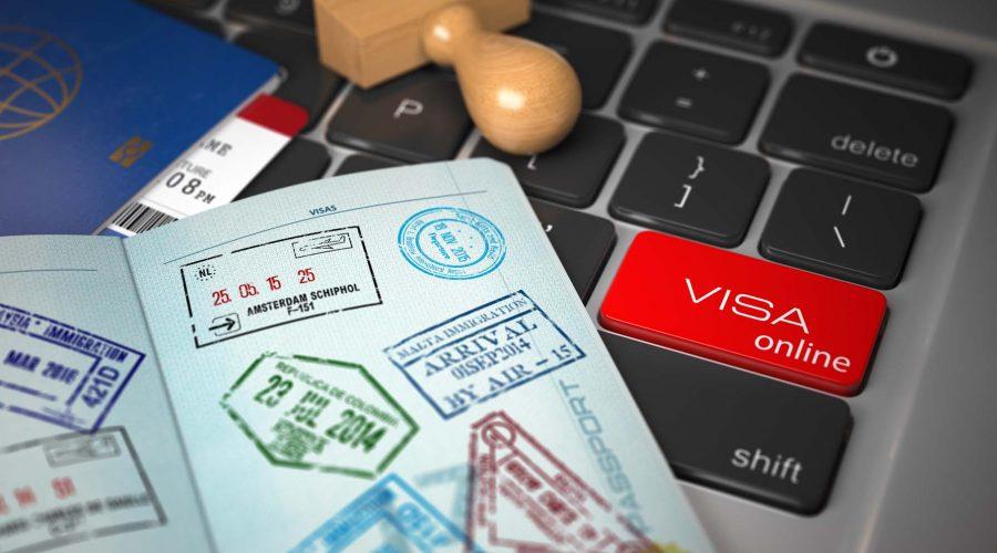 Open passport with visa stamps