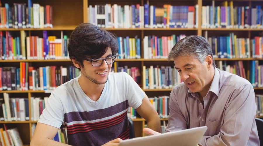Staff member helping a student for course search