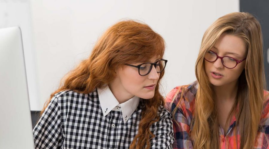 Young students in glasses during lesson