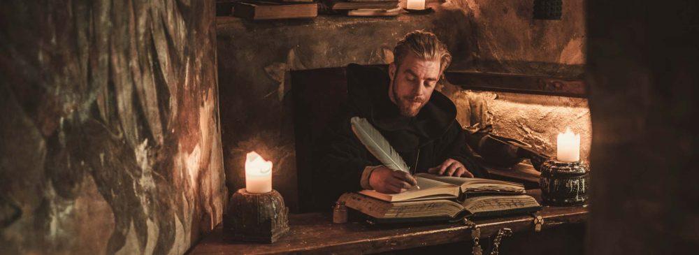 Monk chronicler writes an ancient manuscript