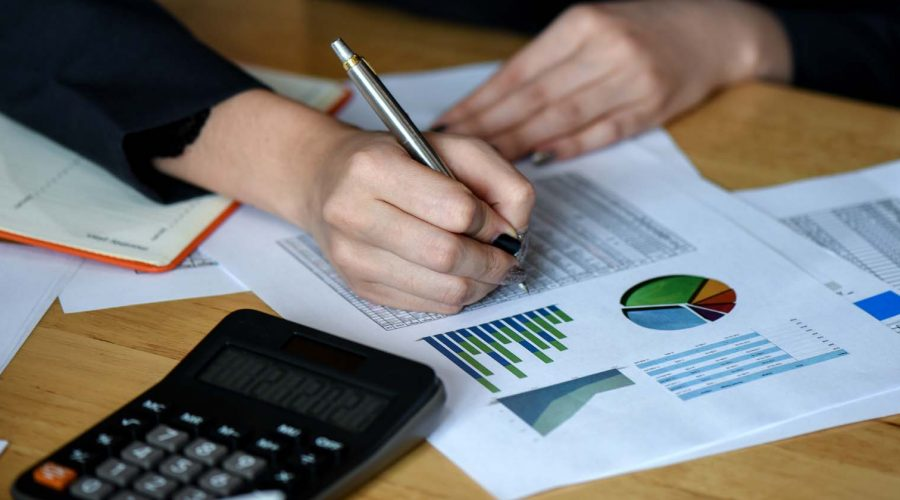 Office staff analyze marketing data on the office desk in the of