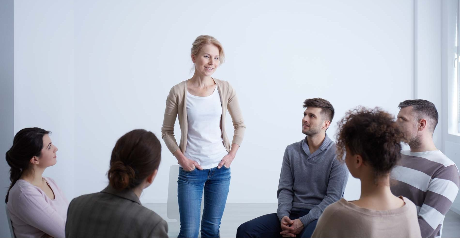 Woman talking during group therapy