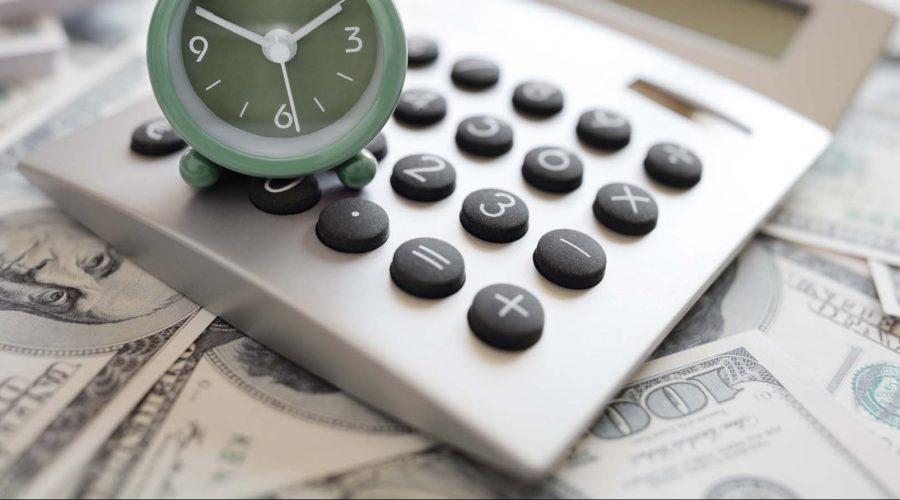 Calculator and alarm clock over money